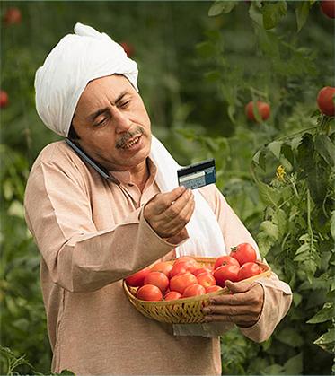 Farmer with ATM Card